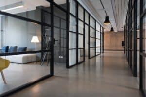 hallway between glass-panel doors inside commercial real estate building